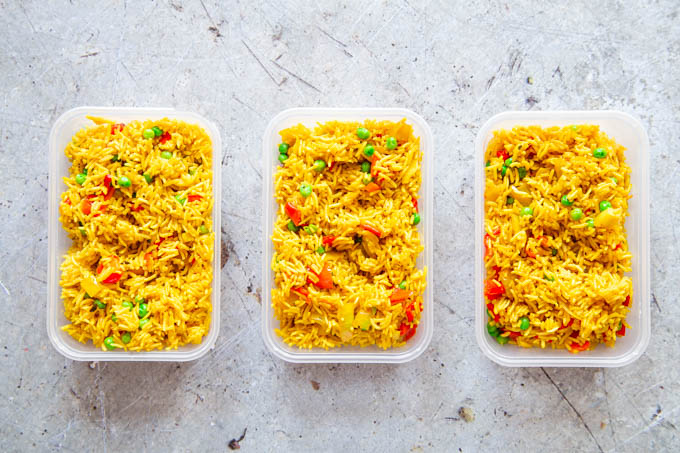 Spicy rice in plastic trays, ready for freezing.