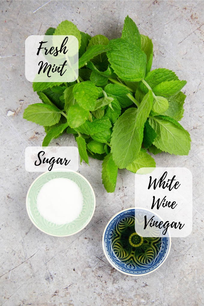 Ingredients for mint sauce - fresh mint, sugar, vinegar.