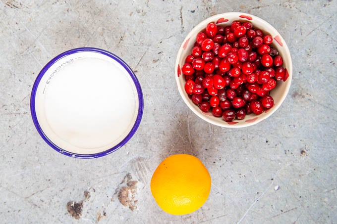 Three ingredients for cranberry sauce - cranberries, sugar and an orange, for the zest.