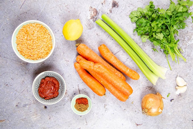 Ingredients for carrot and lentil soup, from above. Carrots, celery, coriander, lemon, lentils, spices, onion, garlic, tomato puree.