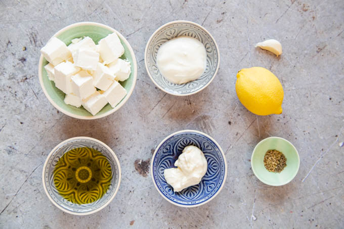Seven ingredients for whipped feta, in small bowls.