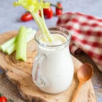 A stick of celery in a jug of homemade salad cream