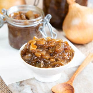 Close up of a small bowl full of onion marmalade.