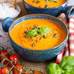 Close up of a bowl of orange soup.