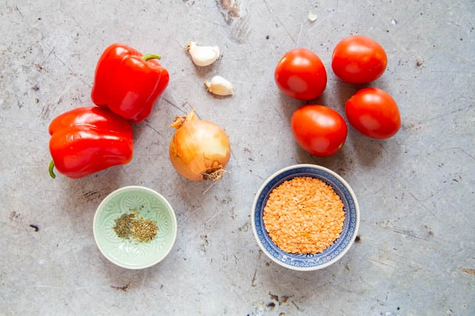 Ingredients for red pepper, tomato and lentil soup - tomatoes, peppers, lentils, onions, garlic, dried herbs.