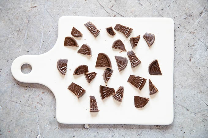 Pieces of chocolate orange cut up on a white board