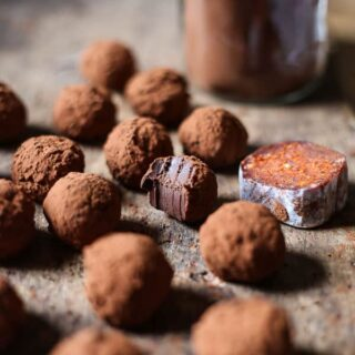 Ndjua chocolate truffles on a wooden board