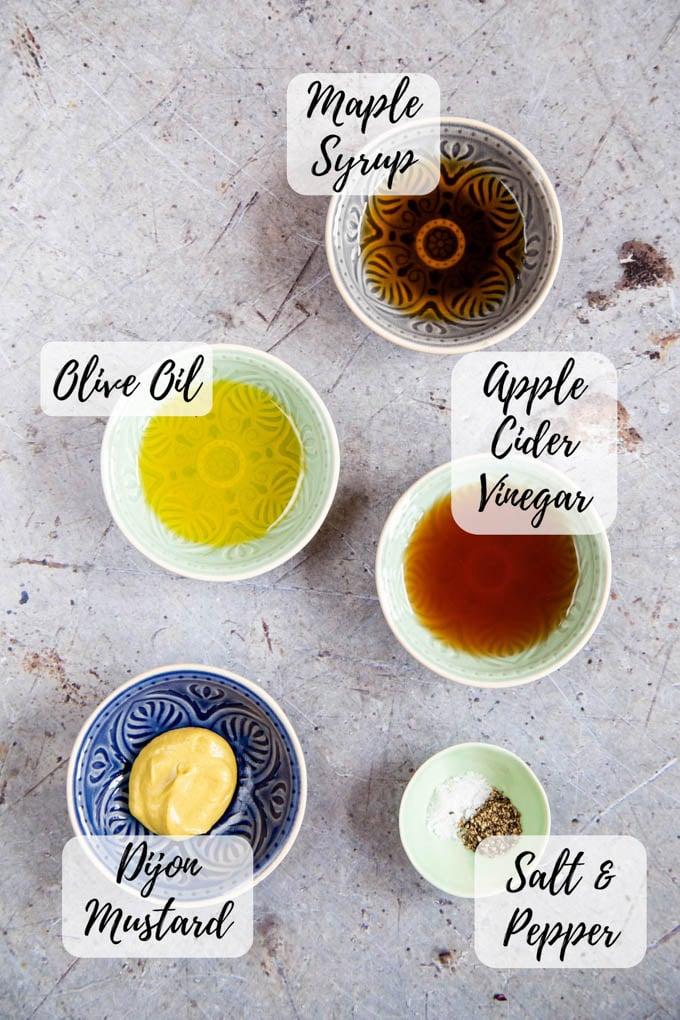 Dressing ingredients - maple syrup, olive oil, apple cider vinegar, Dijon mustard, and salt and pepper.