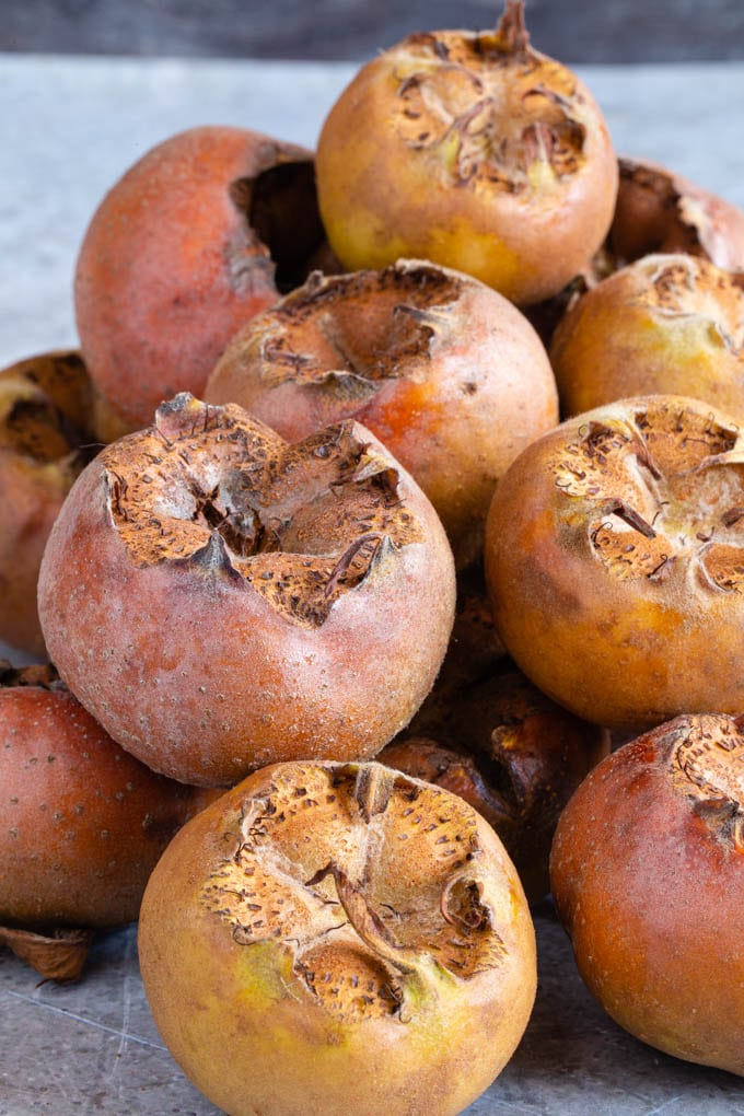 A close up of recently picked medlars.