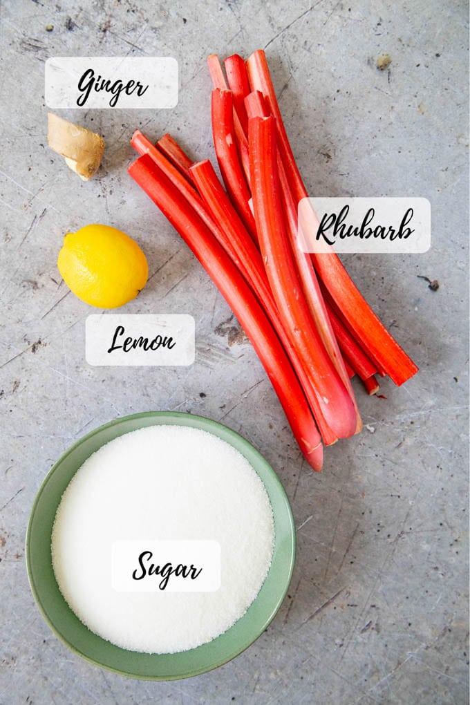 Ingredients for jam - rhubarb, ginger, lemon, and sugar.