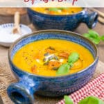 Bowl of bright orange butternut squash soup