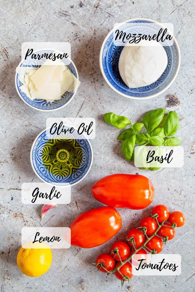 Ingredients: mozzarella, tomatoes , parmesan, basil, olive oil, garlic, and lemon