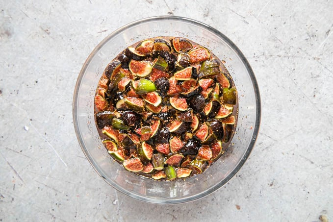 A bowl of cut up figs in a sugar syrup