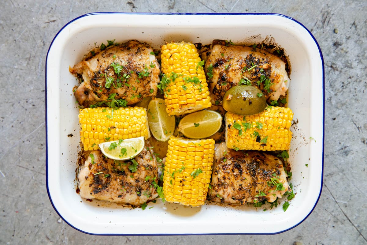 The peri peri chicken and corn on the cob is cooked and ready to serve straight from the roasting dish.