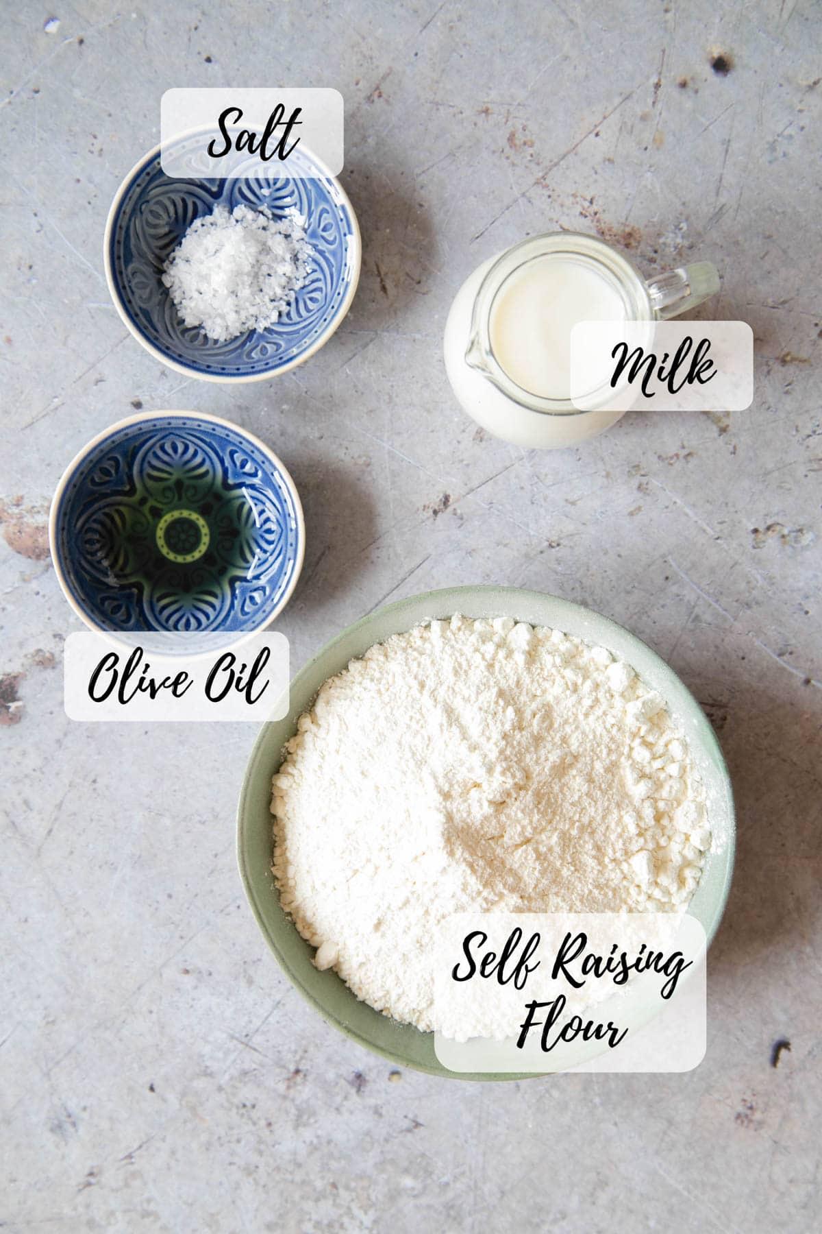 Ingredients for self raising flour bread - white self raising flour, salt, milk, and olive oil.