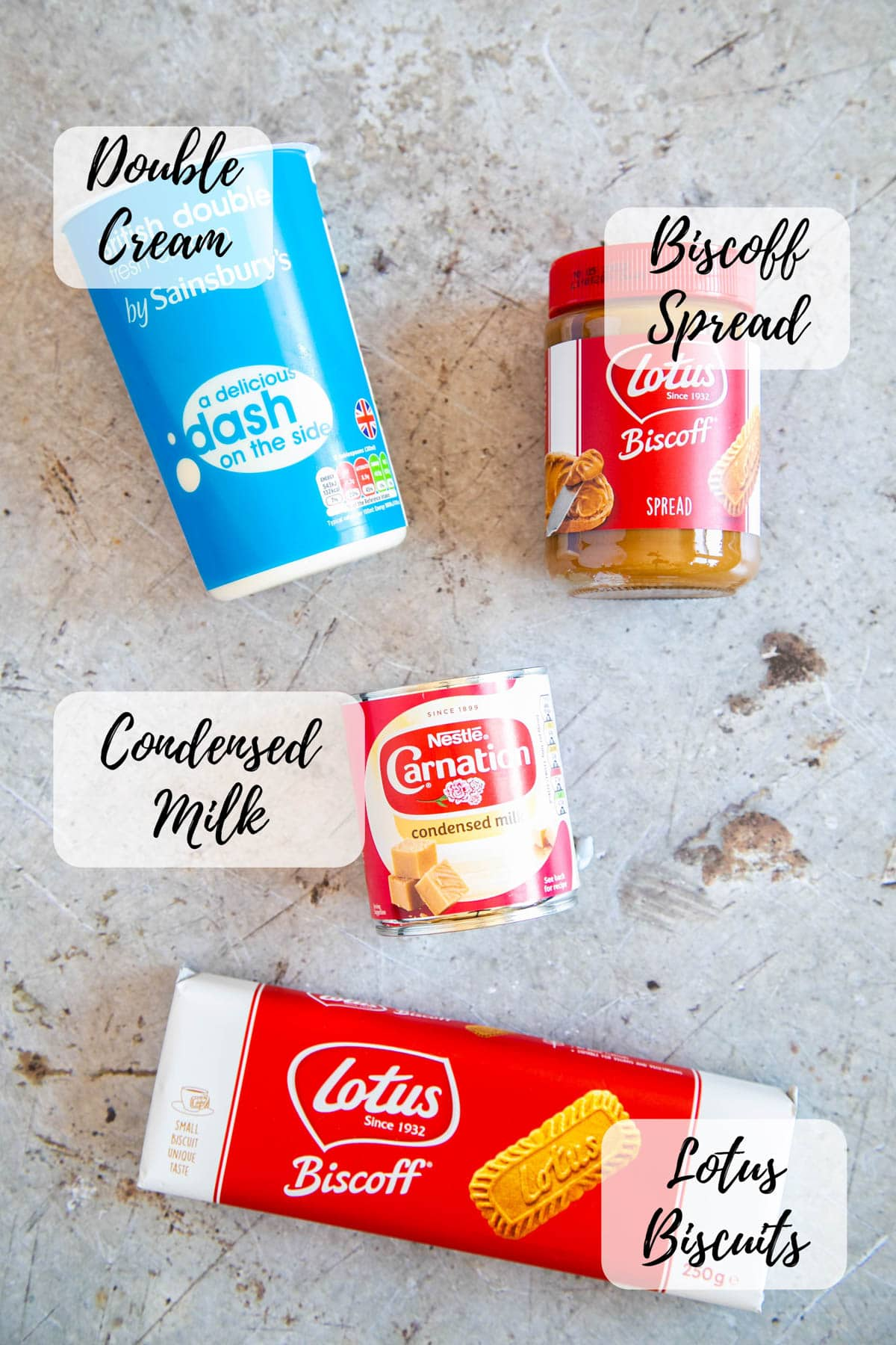 Ingredients for ice cream - double cream, Biscoff spread, condensed milk and Lotus biscuits.
