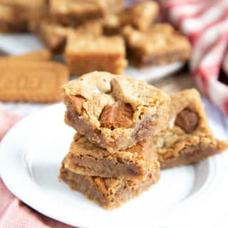 A close up of a stack of Biscoff blondies, showing the chunks o f