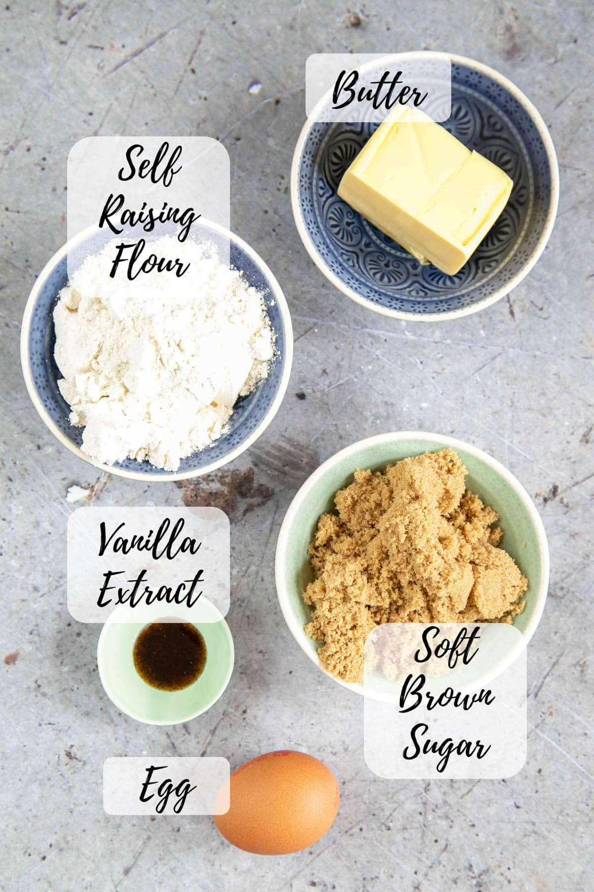 Ingredients for easy blondies: butter, sugar, an egg, vanilla extract, self raising flour. An annotated top down picture of all these ingredents.