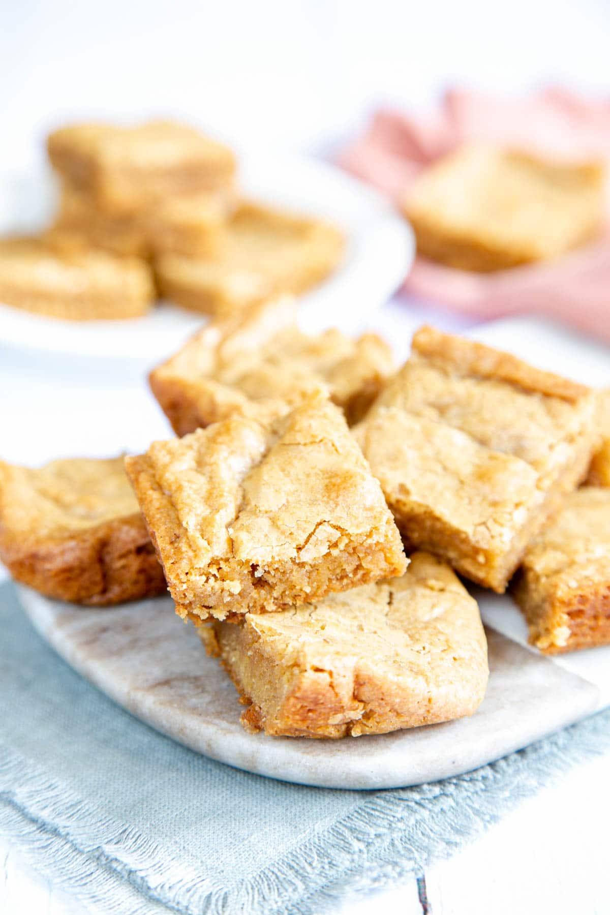 Square blondies arranged on a marble board, ready to enjoy!