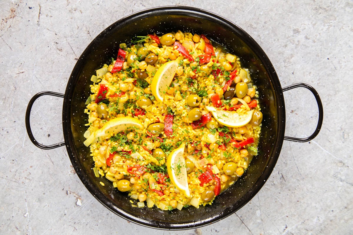 Finished paella garnished with parsley, ready to serve.