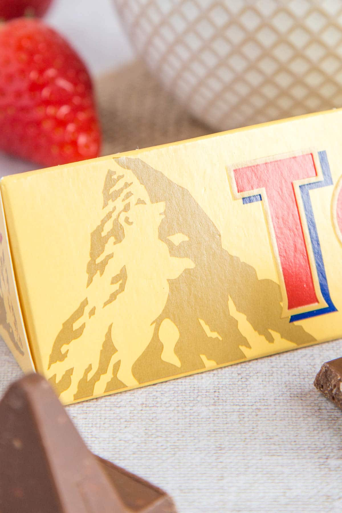 A close up of a Toblerone box showing the bear hidden in the picture of the Matterhorn mountain.