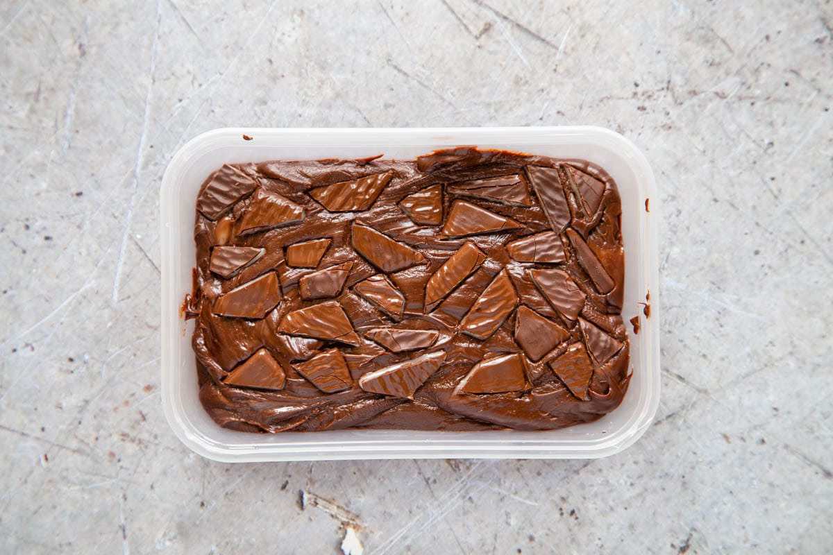 More pieces of After Eight mints have been pressed into to the top of the fudge before it's been chilled.