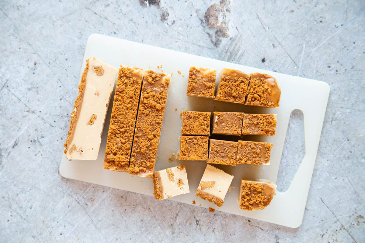 The final stage of making fudge - the chilled fudge is cut into bite-sized pieces.