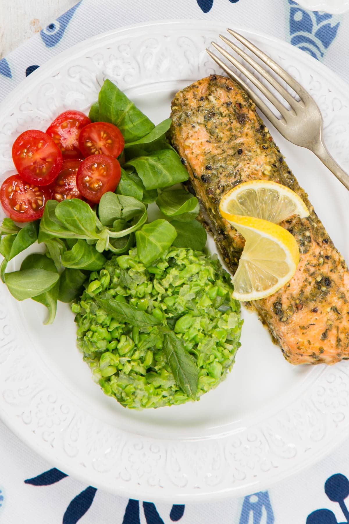 From above: a serving of crushed mint peas, served with hot smoked salmon, bright red tomatoes and peppery watercress.