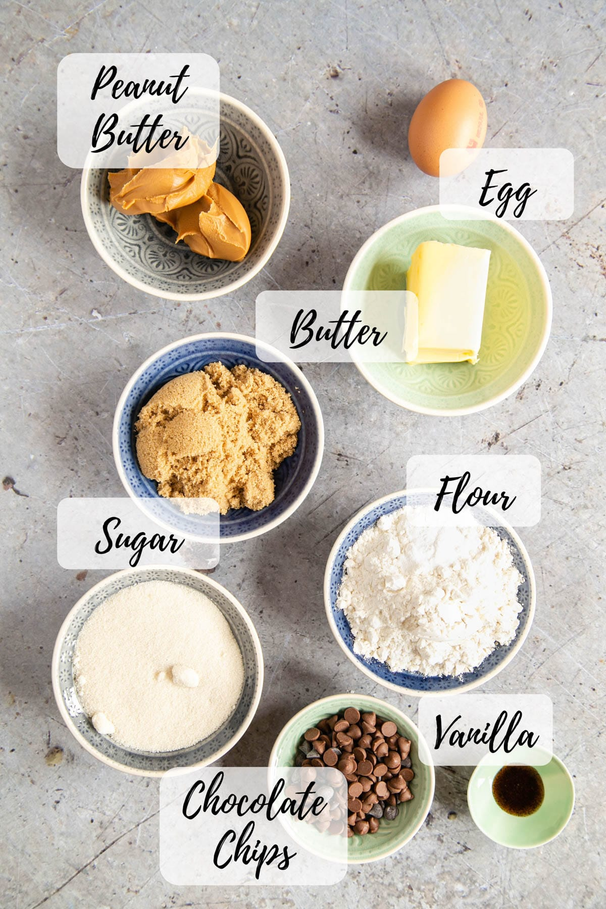 Ingredients for peanut butter blondies: peanut butter, egg, butter, sugar, flour, chocolate chips, vanilla paste