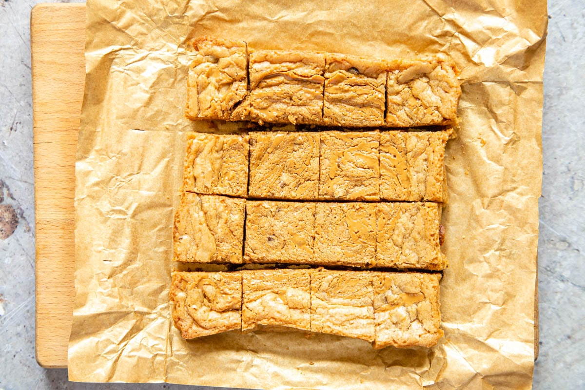 The blondies have been cut into squares, ready to enjoy.