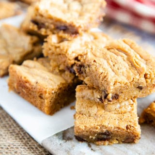 Close up of peanut butter blondies, with chocolate chips visible.