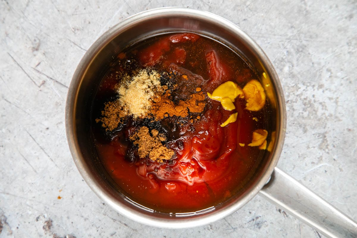 The ingredients for barbecue sauce in a saucepan, ready to be mixed and then reduced.