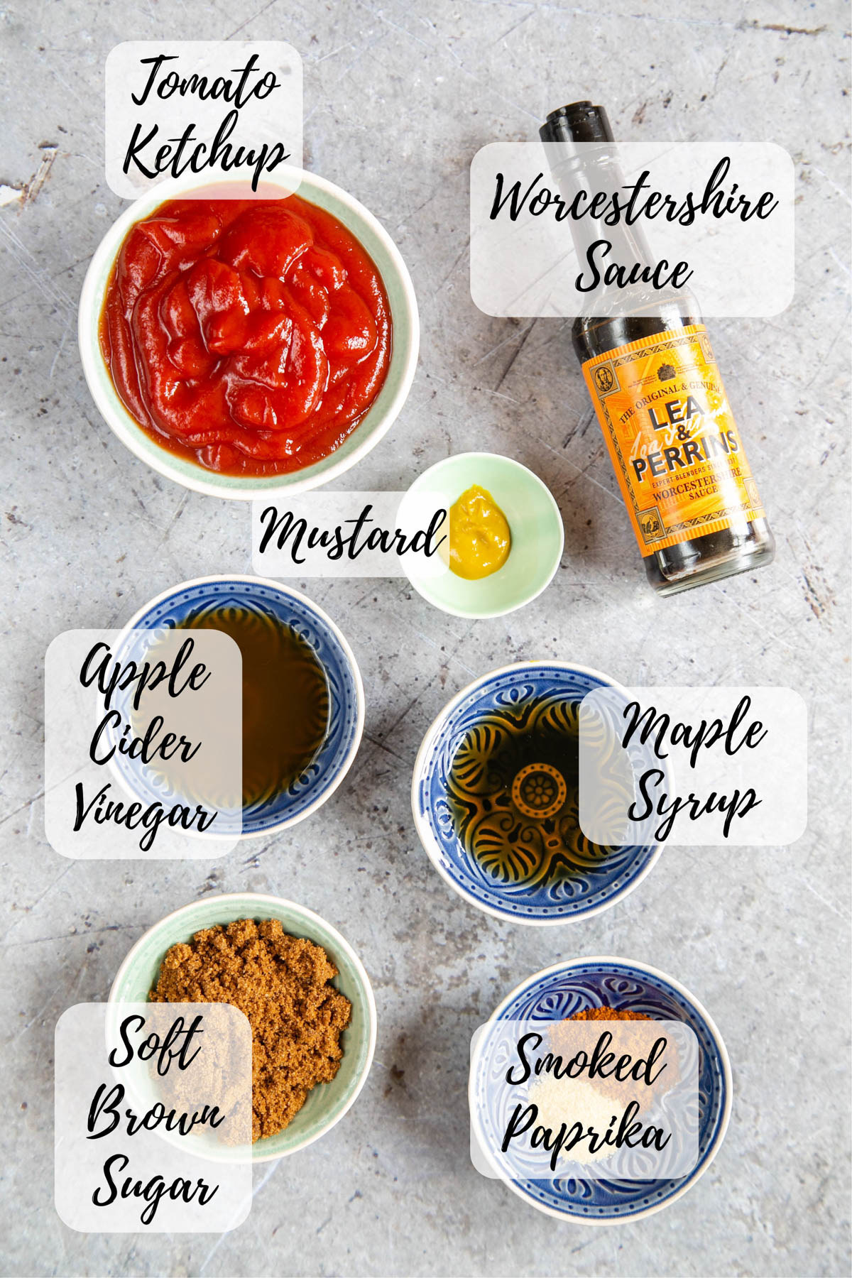 Ingredients for barbecue sauce: tomato ketchup, Worcestershire sauce, mustard, apple cider vinegar, maple syrup, soft brown sugar, and smoked paprika.