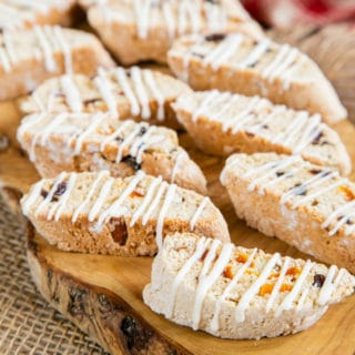 A close up of biscotti glazed with drizzles of icing, ready to serve.