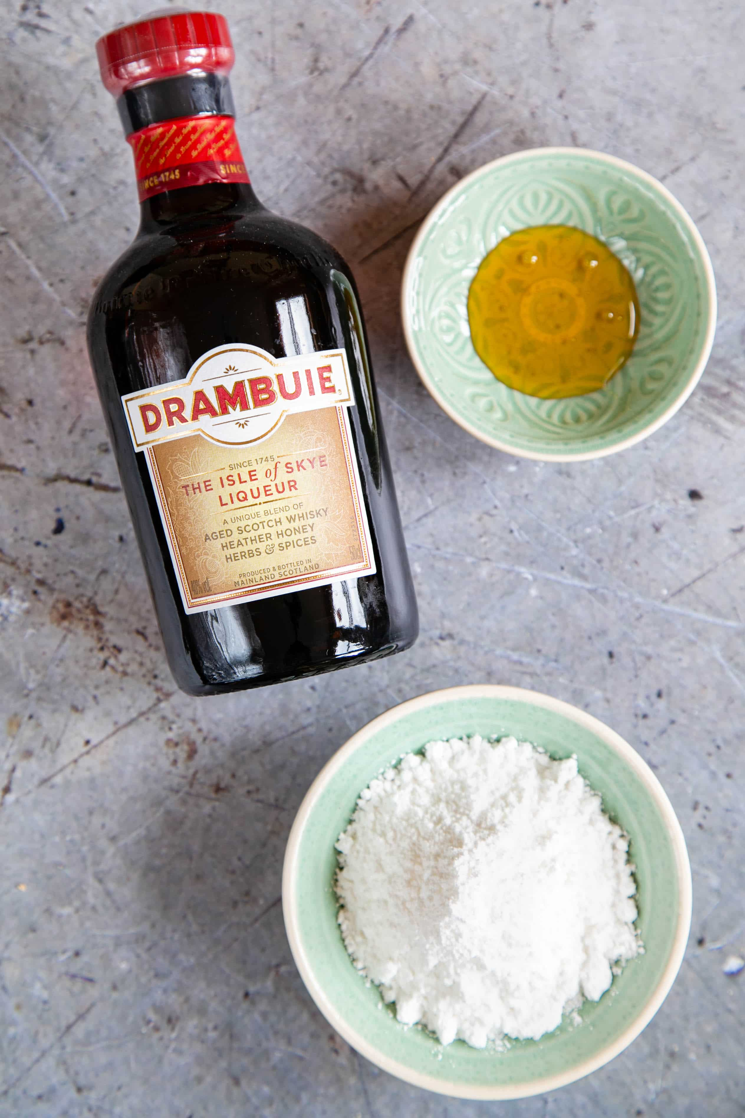 The ingredients for Drambuie icing: Drambuie, icing sugar and golden syrup.