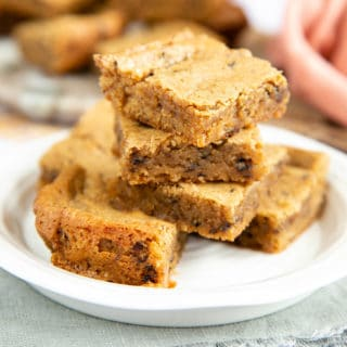 Close up of tasty coffee blondies, showing the moist texture and crumbly top.