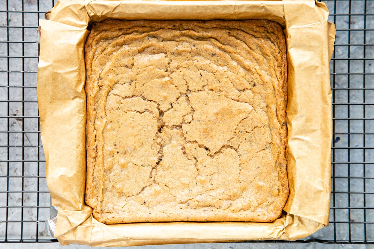 Cooked coffee blondie straight out of the oven. The top is a light golden brown, showing a few cracks.