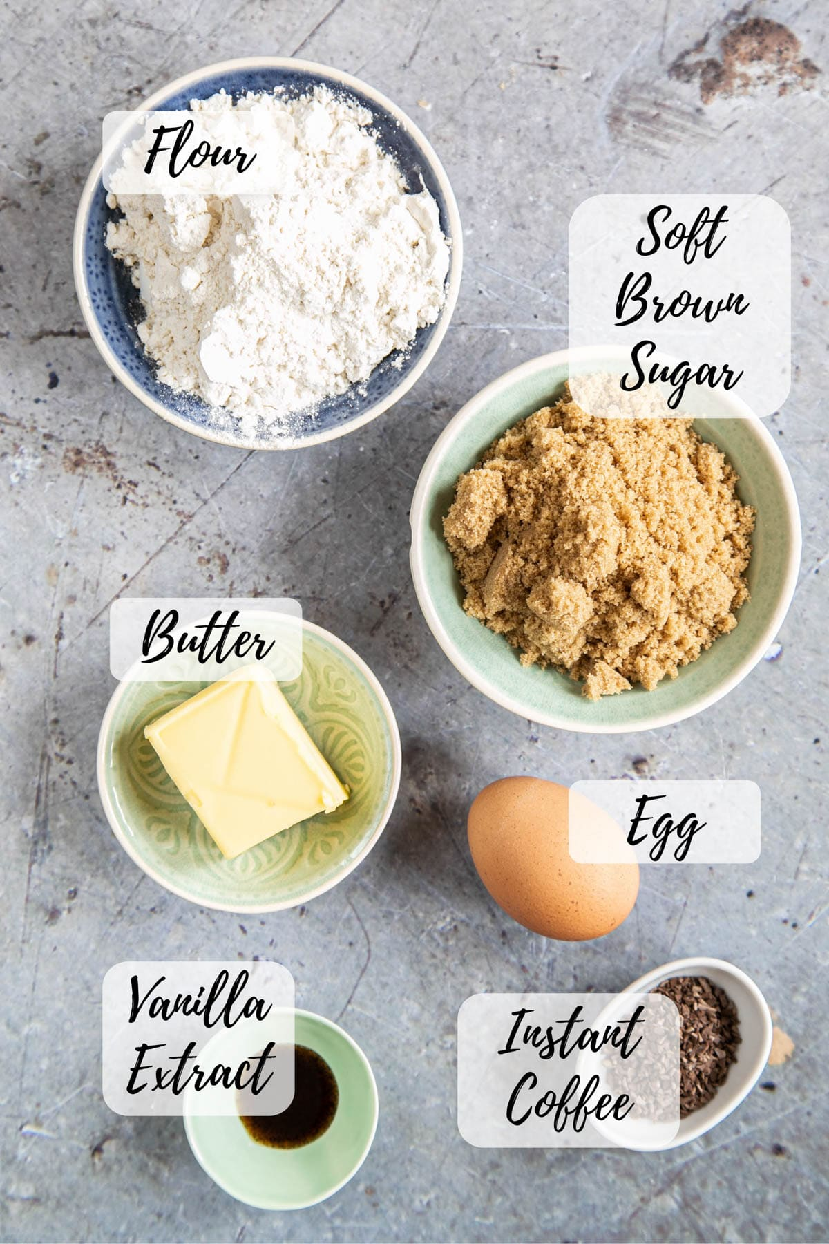 Ingredients for coffee blondies: flour, soft brown sugar, an egg, butter, vanilla extract, and instant coffee.