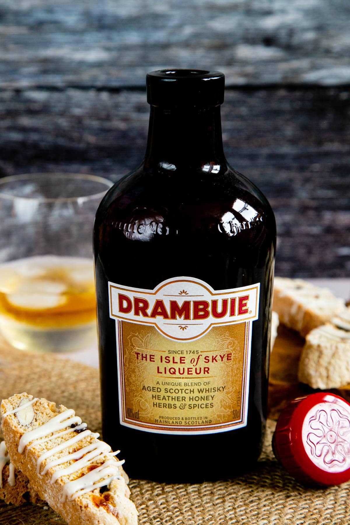 A close up of a bottle of Drambuie liqueur, proudly proclaiming its origins on the Isle of Skye.