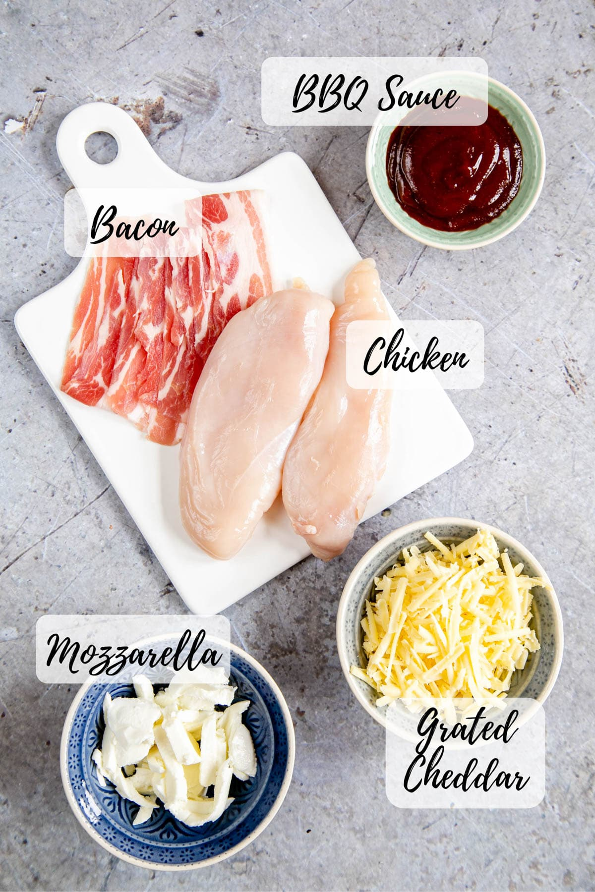 The ingredients for hunters' chicken - chicken breasts, bacon, bbq sauce, mozzarella and cheddar cheese.