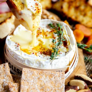 Toasted French bread is dipped in tasty gooey baked camembert