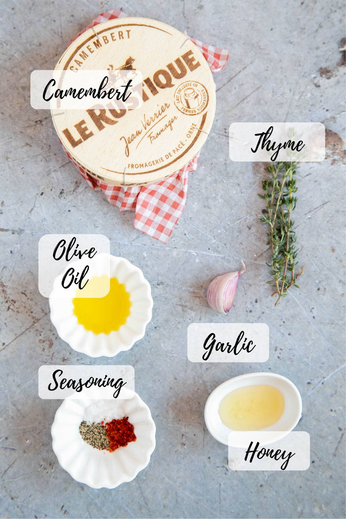 A whole camembert, thyme, a garlic clove, olive oil, seasoning and some honey: text overlay lists the ingredient names