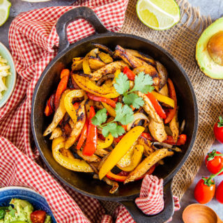 Vibrant yellows and red from the peppers really make this leftover turkey fajita mix look delicious. It's been garnished with some coriander for a splash of green.