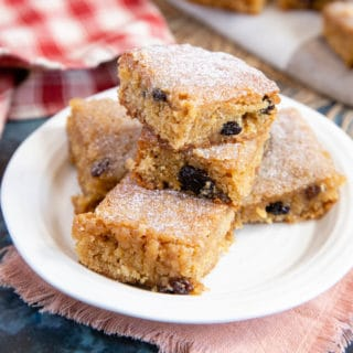 The finished blondies are shown, soft in the middle and dotted with spiced fruit