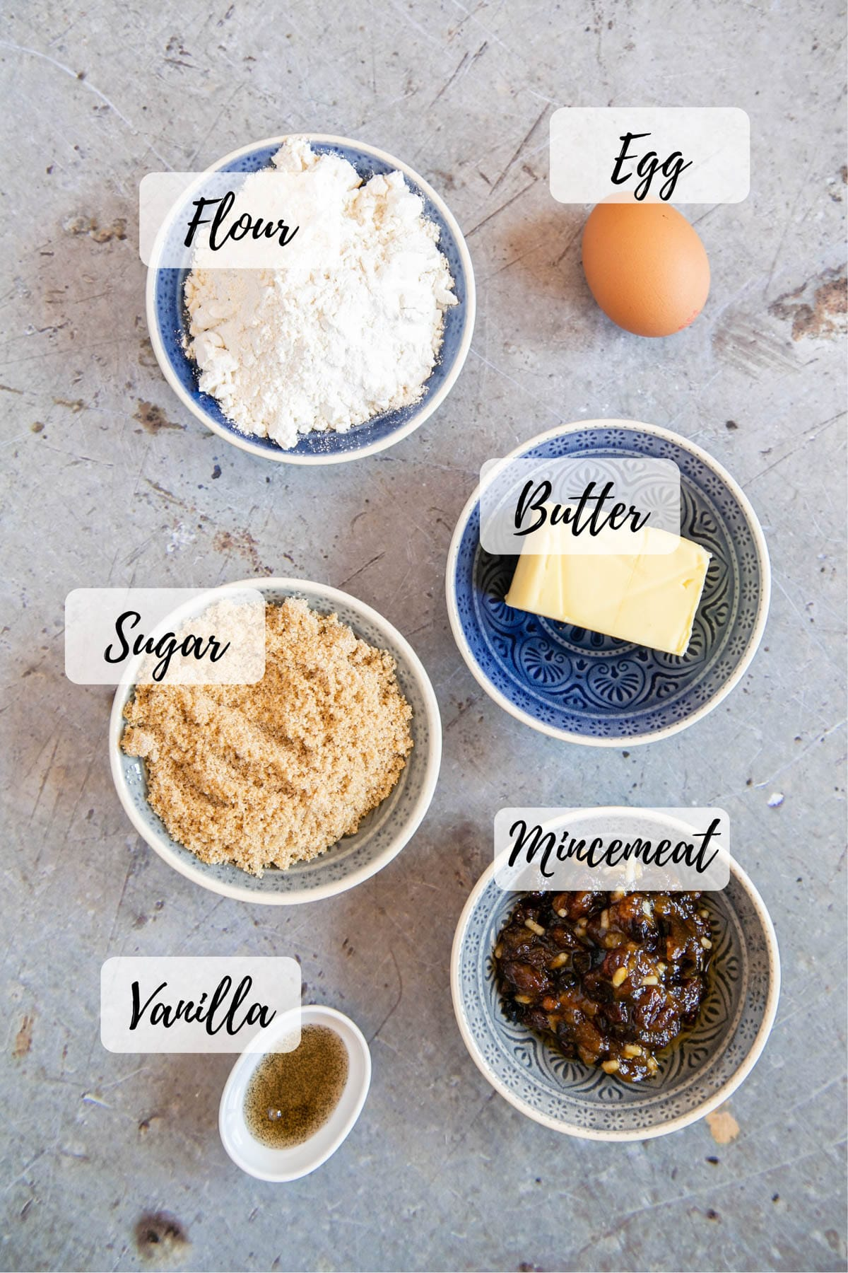 Ingredients collected and ready to use - flour, egg, butter, sugar, vanilla and mincemeat