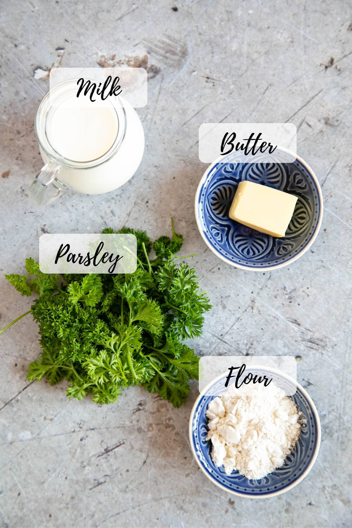 Ingredients for parsley sauce ready for cooking - flour, butter, milk, and parsley.
