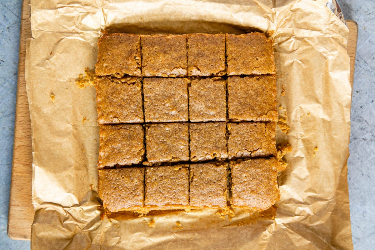 Delicious pumpkin spice blondies, cut into squares, ready to serve and enjoy!